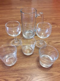 clear glass pitcher with two wine glasses and old-fashioned glasses