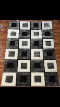 white, black, and brown area rug
