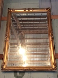 Gold framed mirror with beautiful mold
