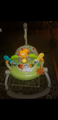 baby's green and white foldable jumparoo 545 km