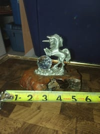 Pewter unicorn  on wood