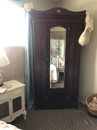 brown wooden cabinet with mirror Kelowna, V1W 1V8