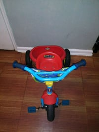 toddler's red and blue trike 234 mi