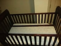 baby's brown wooden crib Phenix City, 36867