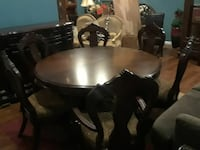 Round table with 6 chairs and buffet server