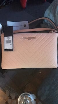 white and black Michael Kors leather wristlet Toronto, M6M