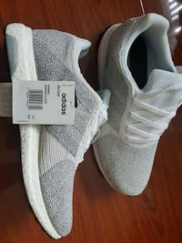 pair of white/ Grey Adidas Ultra Boost shoes