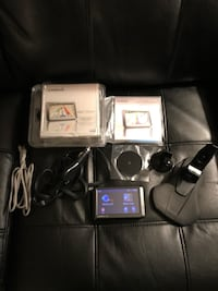 Used Garmin Nuevo 255WT bundle, including large dashboard mount and a USB cable to download updated maps. Sterling, 20164