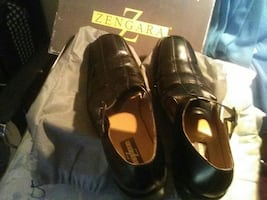 Black leather dress shoes by (ZENGARA)