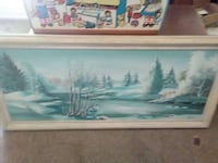 forest filled with snow painting in white wooden frame