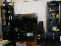 black wooden TV stand and towers 40 km