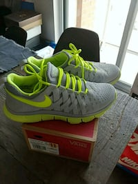 pair of gray-and-green Nike free trainer shoes  Toronto, M6K 1W8