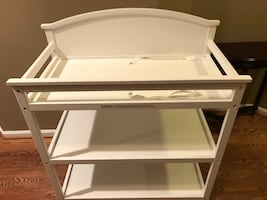 White wooden diaper changing table
