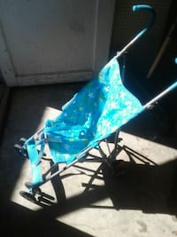 baby's green and blue stroller