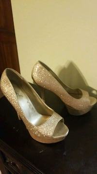 pair of gold-colored platform stilettos
