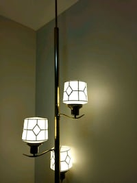 Ceiling to floor Pole lamp.  All lights work.