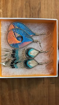 two pairs of chandelier earrrings in box