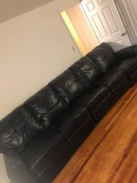 Black Leather Couch, good condition both ends recline and it separates into.  Dayton, 45405
