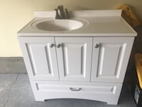 Bathroom vanity with too and faucet   Fort Washington