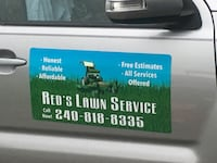 Red's Lawn Service signage 56 km
