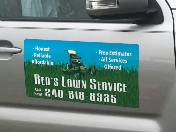 Red's Lawn Service signage