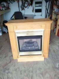 black and brass-colored electric fire place