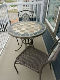 round brown wooden table with two chairs Coalhurst, T0L 0V0