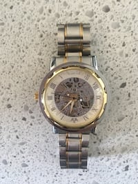 round gold-colored chronograph watch with link bracelet Montréal, H3W 2P7