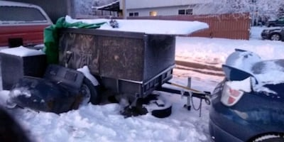 Trailer with large husky tote stored inside trailer