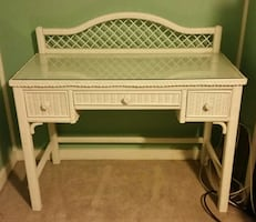 white wicker glass top table