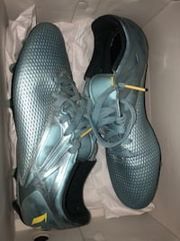 Size 10 Adidas cleats AND chin guard
