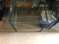 rectangular glass top table with black metal base Fairfax