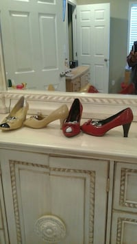 two pairs of beige and red leather heeled shoes