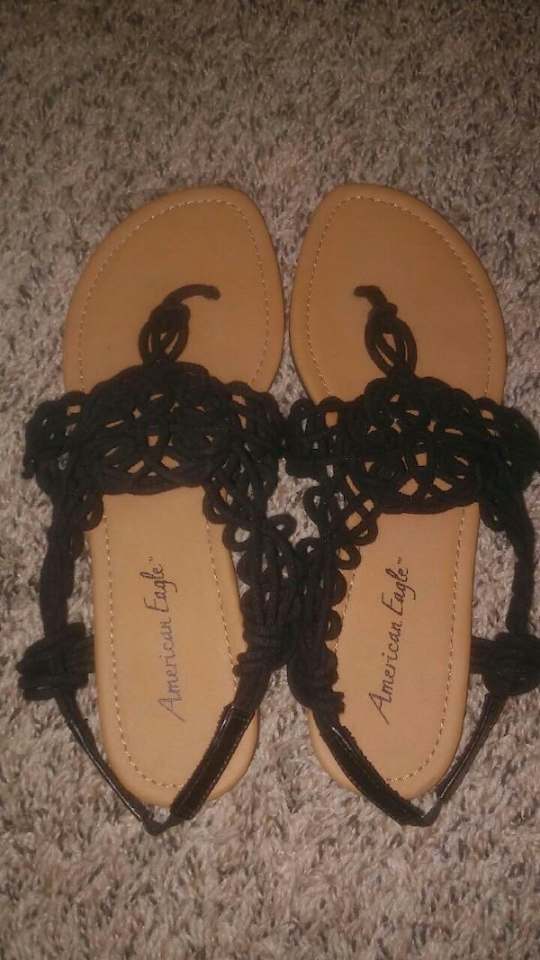 pair of black American Eagle sandals