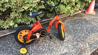 toddler's orange and black bicycle with training wheels Langley, V1M