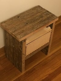 Reclaimed wooden bed side table. The boards are from a semi-truck floor.