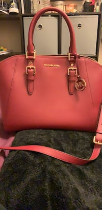Burgundy michael kors leather tote bag only used once.  Watsonville, 95076