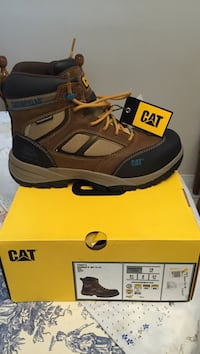 unpaired black and brown hiking sandal with box