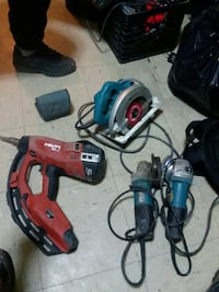 blue circular saw; red nailer; two gray angle grinders