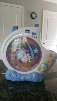 white and blue Fisher-Price activity toy