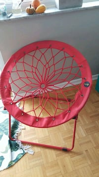 red and yellow bungee chair