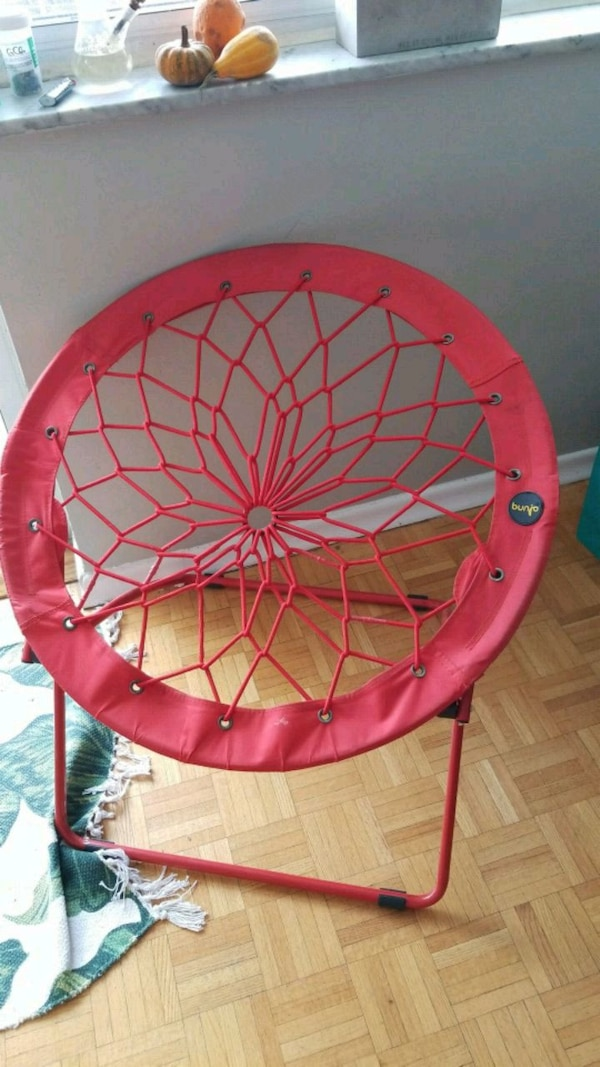 red and yellow bungee chair 7cc5c871-9474-47a0-a5fe-30620f2f8377