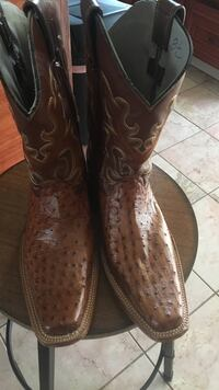 pair of brown leather cowboy boots Thornton, 80241