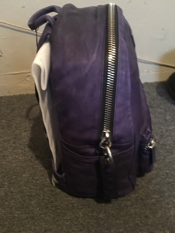 e030a52781 purple and black leather backpack
