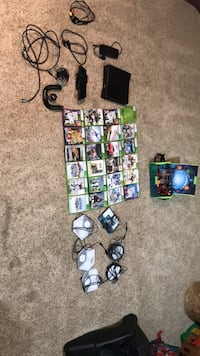 Xbox 360 with  24 games, 2 controllers, all platforms needed for  games, disney infinity and skylander charcters, and all cords needed to set up Herndon, 20170