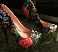 Pair of black and pink floral platform stilettos