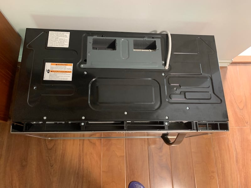 Whirlpool over the range microwave, stainless steel. c7c6a6c6-44d4-4e79-8884-a29099eea507