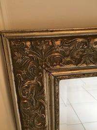 Ornate wall mirror. Bronze tones, perfect for a bath or hallway. Size 27 inches tall by 23 inches wide. Towaco, 07082