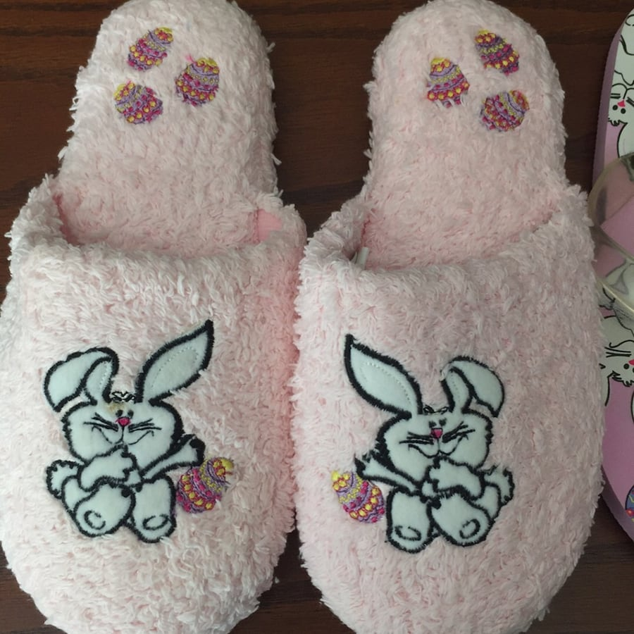 Pair of pink-and-white flipflops and pair of pink house slippers fd347f7a-72c1-4d9f-85bf-06e93e3c70fc