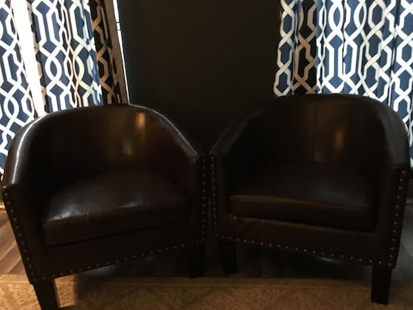 Brown faux leather chairs